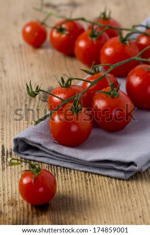Fresh Organic Cherry Tomato on rustic wooden background