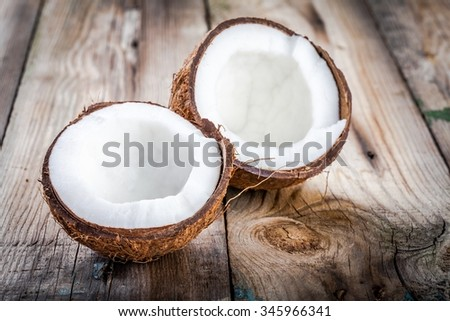 Fresh organic coconut on rustic wooden background - stock photo
