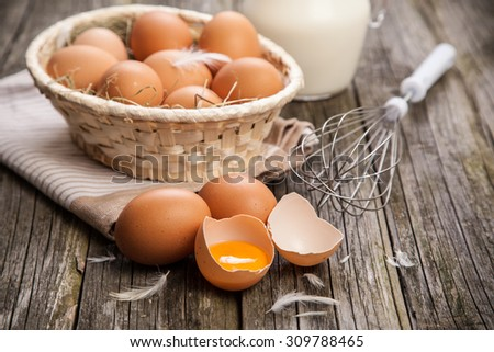 Fresh organic eggs in a basket - stock photo