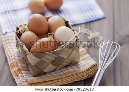 fresh organic eggs on rustic table - stock photo