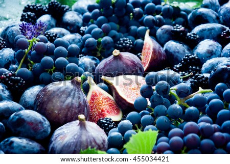 Fresh organic figs, grapes, prunes and dewberry - stock photo