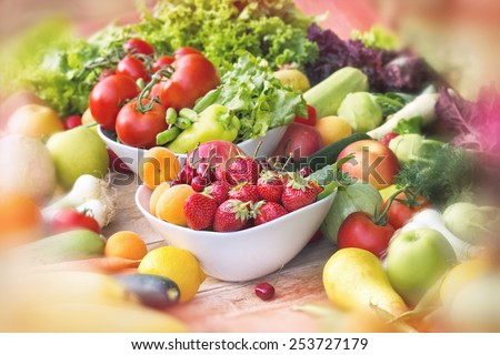 Fresh organic fruits and vegetables on table - stock photo