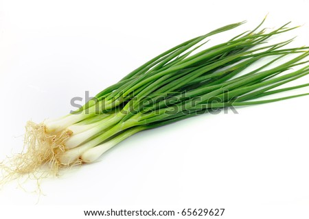 Fresh, organic leeks on white background.