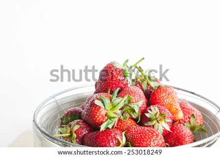 Fresh Organic Long Stem Strawberries in a Bowl. - stock photo