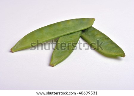 fresh organic mangetout, also known as sugar snap pea