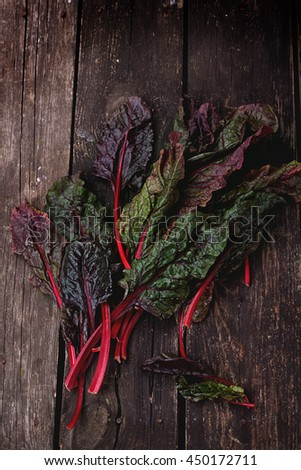 Fresh organic Mangold over a rustic wooden board - stock photo