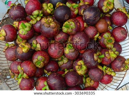 Fresh organic mangosteen fruits at the market in Mekong Delta, southern Vietnam.