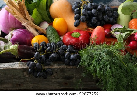 Fresh organic produce in wood crate, food