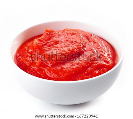 Fresh, organic pureed tomatoes isolated on white - stock photo