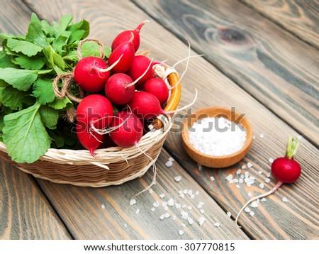 Fresh organic radish on a old wooden background - stock photo
