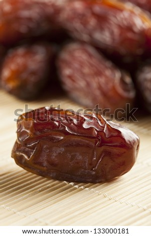 Fresh Organic Raw Brown Date Fruit against a background