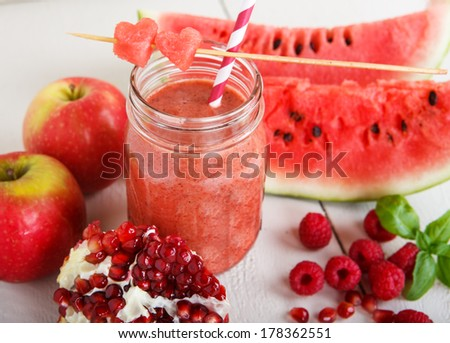 ... , pomegranate, raspberry, strawberry as healthy drink - stock photo
