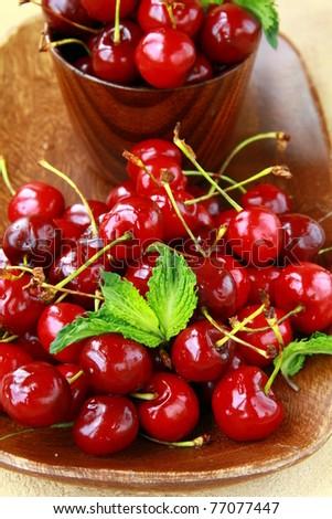 fresh organic ripe black cherry with mint leaf - stock photo