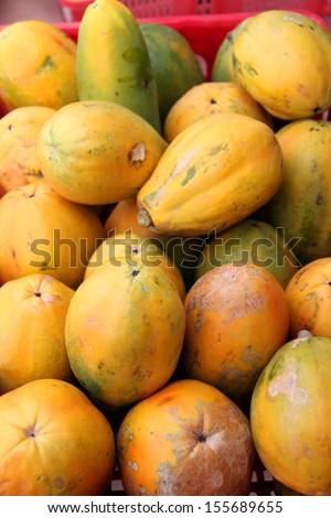 fresh organic ripe papayas at a farmer's market - stock photo