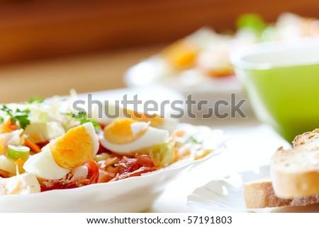 fresh organic salad breakfast prepared on the kitchen table - stock photo