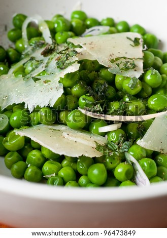 Fresh organic spring pea and pecorino cheese salad - stock photo