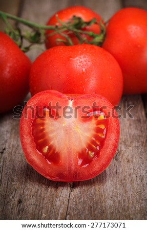 Fresh Organic Tomatoes on the old wooden table
