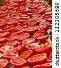 Fresh Organic Tomatoes Under Hot Sun To Dry Fresh organic tomatoes cut in half, salted, and put under the sun to dry. - stock photo