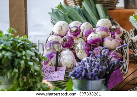 Fresh organic turnip on a basket at market and more vegetables. - stock photo