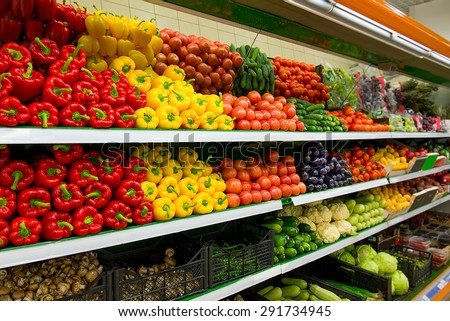 Fresh organic Vegetables and fruits on shelf in supermarket - stock photo
