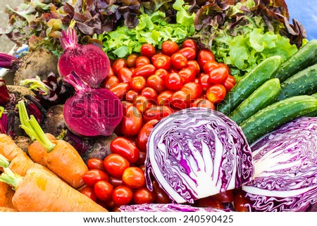 fresh organic vegetables and fruits on table - stock photo