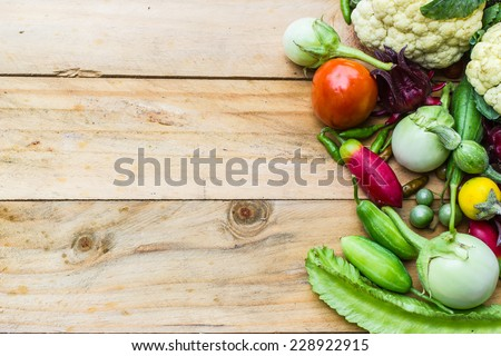 fresh organic vegetables and fruits on wooden background  - stock photo