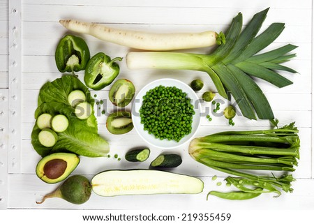 Fresh organic vegetables and fruits on wooden table, close up - stock photo