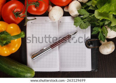 Fresh Organic Vegetables and Spices on a Wooden Background and Paper for Notes. - stock photo