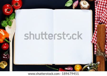 Fresh Organic Vegetables and Spices on a Wooden Background and Paper for Notes. Open Notebook and Fresh Vegetables Background. Italian ingredients - stock photo