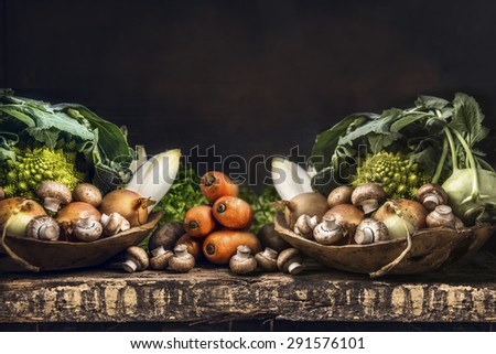 Fresh organic vegetables from garden on old rustic wooden table, vegetarian cooking concept - stock photo