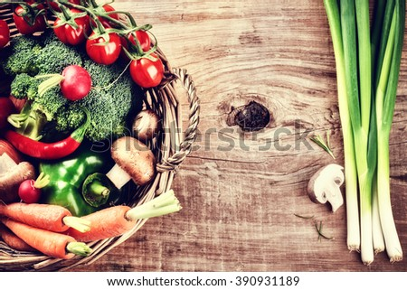 Fresh organic vegetables in basket. Healthy eating and cooking concept
