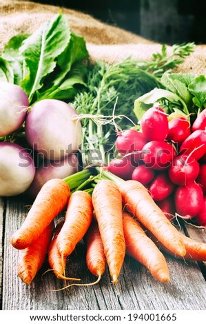 Fresh organic vegetables in rustic setting  - stock photo