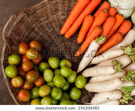 Fresh organic vegetables in wicker baskets at asian market - stock photo