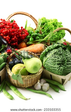 Fresh organic vegetables in wicker baskets, close up - stock photo