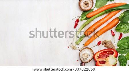 Fresh organic vegetables ingredients for tasty cooking on white wooden background, top view, place for text. Healthy  food  and diet concept. - stock photo