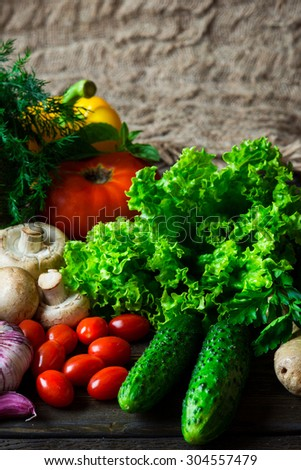 Fresh organic vegetables on a wooden background