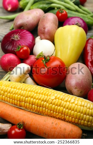 Fresh organic vegetables on wooden background - stock photo