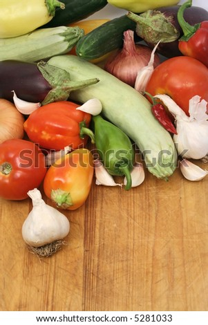 fresh organic vegetables on wooden board, copy space left