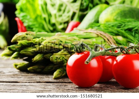 Fresh organic vegetables on wooden table - stock photo