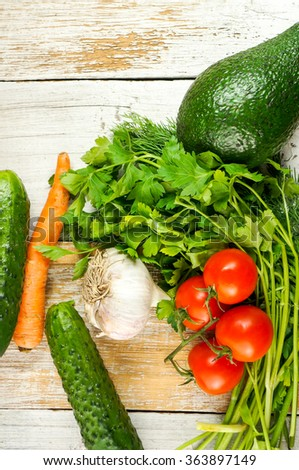 Fresh organic vegetables over retro white table background. top view, view from above