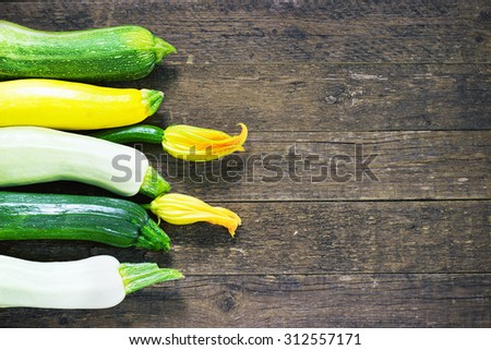 Fresh organic zucchini on the wooden table toning - stock photo