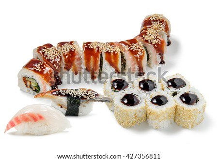Fresh oriental delicacy in close-up of the camera. Tasty sushi with eel, caviar, cucumber, bunch onion and red perch. Isolated. - stock photo