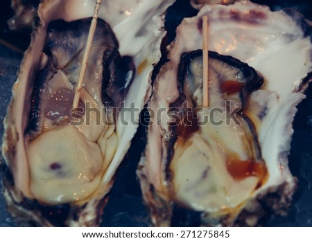 fresh oyster - soft focus with film filter - stock photo