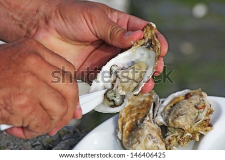 Fresh oysters as well as fine dining, Cancale, France - stock photo