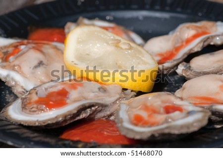 Fresh Oysters with Hot Sauce and Lemon - stock photo