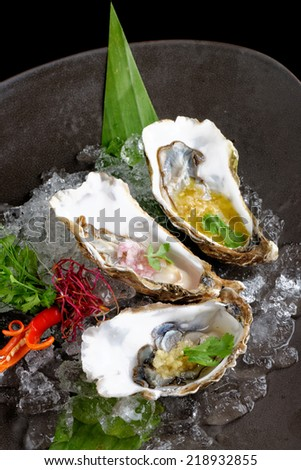 Fresh Oysters with three sauces (cilantro with lime juice, ginger vanilla and pineaple with chili) - stock photo