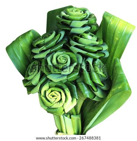 Fresh Pandanus leaf weave to rose bouquet - stock photo