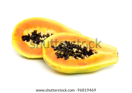 Fresh papaya (carica papaya) in front of a white background