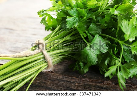 Fresh parsley on wooden background - stock photo