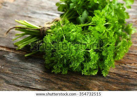 Fresh parsley on wooden background